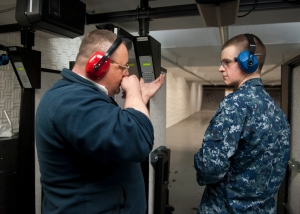 EVERETT, Wash. (Apr. 4, 2013) – Eric Thompson, the range manager for Navy Region Northwest (NRNW) Everett Security, instructs Master-at-Arms Seaman Marc Mumford how to aim down the sights of his M16 service rifle during a weapons requalification course for NRNW Everett Security at the Naval Station Everett (NSE) small arms range aboard NSE. Military personnel attached to NRNW Everett Security began training in separate groups for weapons qualifications on Apr. 3 and will continue throughout the rest of the month at the newly remodeled small arms range aboard NSE. (U.S. Navy photo by Mass Communication Specialist 3rd Class Jonathan A. Colon/ Released)
