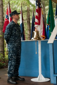SILVERDALE, Wash. (April 10, 2013) Information System Technician 1st Class Chad Villines, assigned to Submarine Group 9, stands by as the bell ringer at the 50th anniversary commemoration ceremony of the USS Thresher (SSN 593) on  Naval Base Kitsap Bangor, April 10. The ceremony honored the 129 service members who lost their lives on the USS Thresher (SSN 593), which sank off the coast of Cape Cod on April 10, 1963. (U.S. Navy photo by Mass Communication Specialist Seaman Apprentice William Blees/Released)