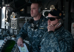 130429-N-QY316-106 EVERETT, Wash. (April 29, 2013) Boatswain's Mate 3rd Class Jesse Watson and Chief Operations Specialist Jason Vela, assigned to the Oliver Hazard Perry-class guided missile frigate USS Ford (FFG 54), communicate during the departure from Naval Station Everett to participate in Exercise Trident Fury. Trident Fury is a biennial joint and multinational naval training exercise led by the Royal Canadian Navy and is designed to provide mutually beneficial, realistic and relevant training necessary for an effective global Navy. Exercises like Trident Fury strengthen the U.S. Navy's ability to respond to crises and protect the collective maritime interests of the U.S. and its allies and partners. (U.S. Navy photo by Mass Communication Specialist Seaman Apprentice William Blees/RELEASED)