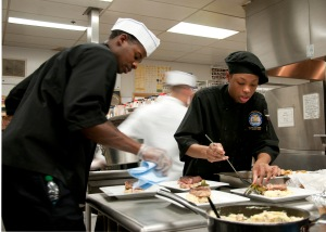 120512-N-ZF573-044 BREMERTON, Wash. (May 12, 2012) Culinary Specialist Seaman Jamika Miner and Culinary Specialist 2nd Class Vince Wilson, both assigned to the aircraft carrier USS John C. Stennis (CVN 74), prepare their plates of food during the iron chef event. Teams of two competed during Naval Base Kitsap's 20th Annual Armed Forces Culinary Arts Competition. (U.S. Navy Photo by Mass Communication Specialist Seaman Chris Brown/Released)