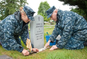 MARYSVILLE, Wash. (May 23, 2013) Operations Specialist 1st Class Christine Rondenelli and Machinist's Mate 1st Class Christopher Nentwich maintain a gravesite at the Marysville Cemetery during a CPO 365 community relations project. During the event, Sailors maintained graves of veterans at the cemetery in preparation for Memorial Day. CPO 365, a year-long development and training program for 1st class petty officers, was first introduced in 2010 under former Master Chief Petty Officer of the Navy Rick West. (U.S. Navy photo by Mass Communication Specialist 2nd Class Jeffry A. Willadsen/Released)