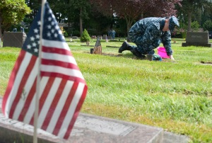 MARYSVILLE, Wash. (May 23, 2013) Chief Cryptologic Technician Jonathon Morgan cleans a gravestone at the Marysville Cemetery during a CPO 365 community relations project. During the event, Sailors maintained graves of veterans at the cemetery in preparation for Memorial Day. CPO 365, a year-long development and training program for 1st class petty officers, was first introduced in 2010 under former Master Chief Petty Officer of the Navy Rick West. (U.S. Navy photo by Mass Communication Specialist 2nd Class Jeffry A. Willadsen/Released)