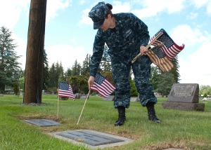 MARYSVILLE, Wash. (May 23, 2013) Electronics Technician 1st Class Tracy Rico places an American flag at a gravesite at the Marysville Cemetery during a CPO 365 community relations project. During the event, Sailors maintained graves of veterans at the cemetery in preparation for Memorial Day. CPO 365, a year-long development and training program for 1st class petty officers, was first introduced in 2010 under former Master Chief Petty Officer of the Navy Rick West. (U.S. Navy photo by Mass Communication Specialist 2nd Class Jeffry A. Willadsen/Released)