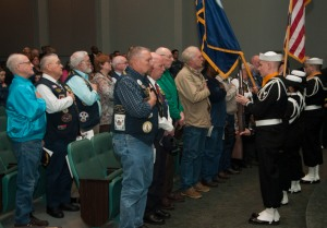 "KEYPORT, Wash. (May 23, 2013) Submarine Veterans stand at attention while the national anthem is played at a ""Tolling of the Boats"" ceremony at the Naval Undersea Museum Jack Murdock Auditorium in Keyport, Wash. The ceremony honors the memory of the submariners who lost their lives in the line of duty, especially those during World War II. In the ceremony, the names of every U.S. submarine lost, along with the fate of its crew, are read aloud as a ship's bell is tolled for each in turn. (U.S. Navy photo by Mass Communication Specialist 3rd Class Chris Brown/Released)"