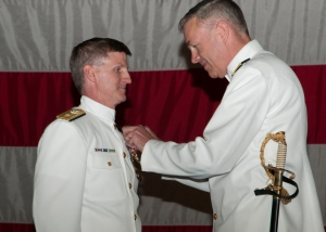 BREMERTON, Wash. (June 14, 2013) Vice Adm. William French, Commander, Navy Installations Command, awards Rear Adm. Mark Rich with the Legion of Merit during the Navy Region Northwest Change of Command Ceremony on Naval Base Kitsap. During the ceremony Rich relieved by Rear Adm. (select) Bette Bolivar. (U.S. Navy photo by Mass Communication Specialist Seaman Apprentice William Blees/Released)