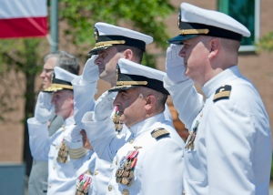 EVERETT, Wash. (July 2, 2013) Capt. Michael J. Coury (center right), and other members of the official party, salute during a change of command ceremony at Jackson Plaza on Naval Station Everett (NSE). Capt. James J. Duke relieved Coury as commanding officer of NSE during the ceremony. (U.S. Navy photo by Mass Communication Specialist 2nd Class Jeffry Willadsen/Released)