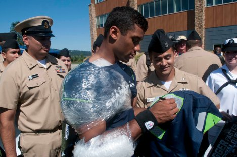 RENTON, Wash. (August 21, 2013) Hospital Corpsman 3rd Class Michael Pulkrabek, assigned to Naval Branch Health Clinic Everett, gets an autograph from Seattle Seahawks quarterback Russell Wilson after a team practice in Renton, Wash. The Seahawks hosted more than 100 Sailors for their practice and a meet and greet with the players. (U.S. Navy photo by Mass Communication Specialist 2nd Class Justin A. Johndro/Released)