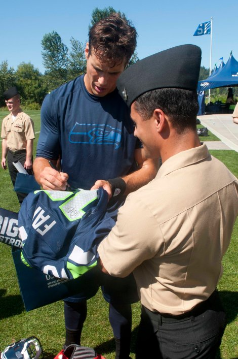 RENTON, Wash. (August 21, 2013) Hospital Corpsman 3rd Class Michael Pulkrabek, assigned to Naval Branch Health Clinic Everett, gets an autograph from Seattle Seahawks quarterback Brady Quinn after a team practice in Renton, Wash. The Seahawks hosted more than 100 Sailors for their practice and a meet and greet with the players. (U.S. Navy photo by Mass Communication Specialist 2nd Class Justin A. Johndro/Released)