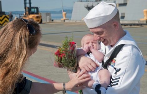 EVERETT, Wash. (August 22, 2013) Ship's Serviceman 1st Class Chris Wiese holds his newborn son, Dusty, after the Arleigh Burke-class guided-missile destroyer USS Momsen (DDG 92) returned to her homeport of Naval Station Everett. Momsen concluded a four-month Western Pacific deployment supporting security and stability in the U.S. 7th Fleet area of responsibility. (U.S. Navy photo by Mass Communication Specialist 2nd Class Jeffry A. Willadsen/Released)