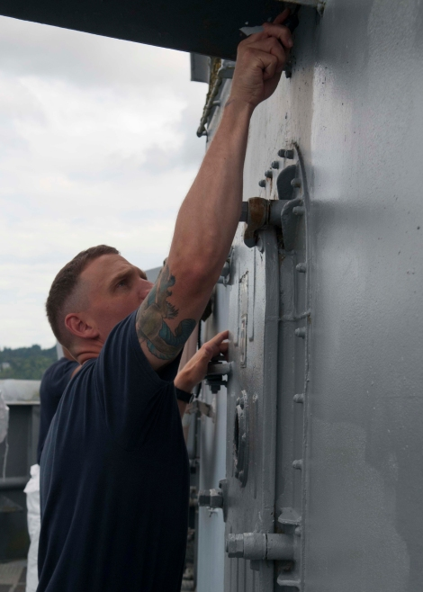 BREMERTON, Wash. (Aug. 28, 2013) Chief (select) Aviation Ordnanceman Besmer Warthen scrapes paint off of the museum ship USS Turner Joy. Warthen, along with more than 100 chief petty officer (CPO) selects, have been maintaining the ship's condition since Sunday as part of a community relations project. The CPO selects, Sailors undergoing Phase II of CPO 365, boarded USS Turner Joy Aug. 25 to participate in the Pacific Northwest 2nd Annual CPO Legacy Academy to spend a week living, working, and training aboard the Vietnam War-era ship along with a group of CPO mentors who will provide leadership and lessons on naval history as well as the heritage of the CPO community. (U.S. Navy photo by Mass Communication Specialist 2nd Class Justin A. Johndro/Released)