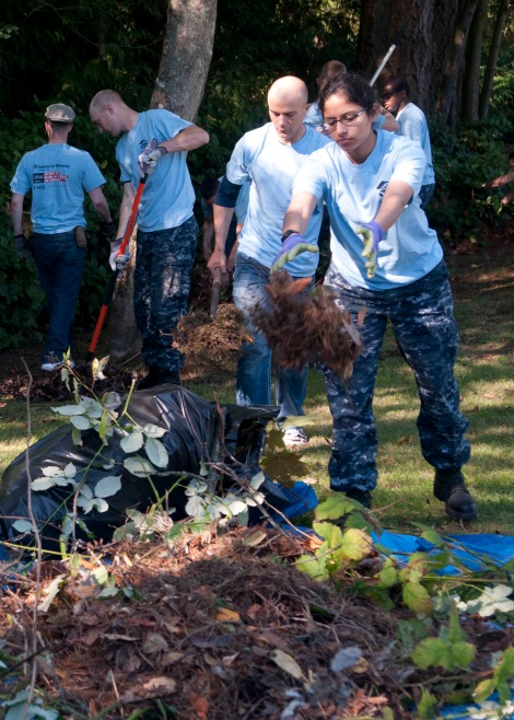 BREMERTON, Wash. (Sept. 11, 2013) Seaman Bethany Rios, assigned to the aircraft carrier USS John C. Stennis (CVN 74) throws leaves onto a discard pile for a Habitat for Humanity project at Bataan Park. Sailors and Marines assigned to MCSFBn and the aircraft carrier USS John C. Stennis (CVN 74) volunteered to help clean and revitalize the park as part of a community service project to commemorate the terrorist attacks on the World Trade Center on 9/11. (U.S. Navy photo by Mass Communication Specialist 2nd Class Justin A. Johndro/Released)
