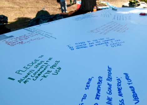 BREMERTON, Wash. (Sept. 11, 2013) Sailors and Marines assigned to Marine Corps Security Force Battalion on Naval Base Kitsap Bangor, signed a banner to commemorate 9/11 during a Habitat for Humanity Project at Bataan Park. Sailors and Marines assigned to MCSFBn and the aircraft carrier USS John C. Stennis (CVN 74) volunteered to help clean and revitalize the park as part of a community service project to commemorate the terrorist attacks on the World Trade Center on 9/11. (U.S. Navy photo by Mass Communication Specialist 2nd Class Justin A. Johndro/Released)