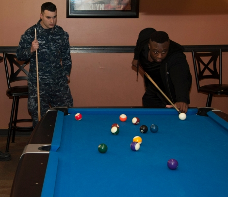 "BREMERTON, Wash. (Dec. 11, 2013) Big E Langston, World Wrestling Entertainment (WWE) wrestler, plays pool during a meet and greet autograph signing session at Naval Base Kitsap.  WWE athletes visited military installations throughout the Pacific Northwest as part of their 10th annual ""Tribute to the Troops"" performance at Joint Base Lewis-McChord, which will air on Dec. 19 and Dec. 28. WWE Tribute to the Troops is an annual event held by WWE with Armed Forced Entertainment as a way of honoring the men and women of the Armed Forces. (U.S. Navy photo by Mass Communication Specialist 2nd Class Chris Brown/Released)"