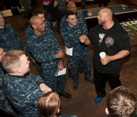 "BREMERTON, Wash. (Dec. 11, 2013) Ryback, World Wrestling Entertainment (WWE) wrestler, shares stories with Sailors during a meet and greet autograph signing session at Naval Base Kitsap. WWE athletes visited military installations throughout the Pacific Northwest as part of their 10th annual ""Tribute to the Troops"" performance at Joint Base Lewis-McChord, which will air on Dec. 19 and Dec. 28. WWE Tribute to the Troops is an annual event held by WWE with Armed Forced Entertainment as a way of honoring the men and women of the Armed Forces. (U.S. Navy photo by Mass Communication Specialist 2nd Class Chris Brown/Released)"