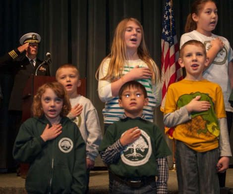 "KEYPORT, Wash. (Jan. 14, 2014) Capt. David Kohnke, Naval Undersea Warfare Center commanding officer, salutes the flag as Silverwood School students perform the national anthem during a Dr. Martin Luther King, Jr. commemoration event at the Naval Undersea Museum Jack Murdock Auditorium in Keyport, Wash. The theme for 2014 was ""A Day on! Not a day off!"". (U.S. Navy photo by Mass Communication Specialist 2nd Class Chris Brown/Released)"