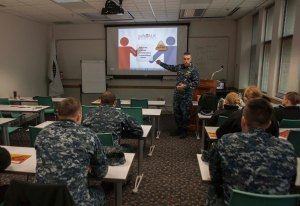 "140129-N-MM360-017 EVERETT, Wash. (Jan. 29, 2013) – Lt. Cmdr. Carl Stamper, the Naval Station Everett (NSE) Command Chaplain, teaches a ""Safe Talk"" suicide intervention course on NSE. The course was meant to teach Sailors how to recognize sufferers of suicidal thoughts, talk to them, and get them the help they need. (U.S. Navy photo by Mass Communication Specialist 2nd Class Jeffry A. Willadsen/Released)"