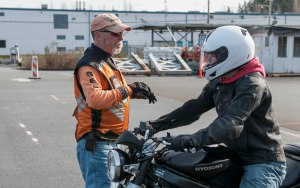 140220-N-MN975-007 KEYPORT, Wash. (February 20, 2014) - Robert Altman, motorcycle range supervisor and instructor provides riding technique feedback to Aviation Boatswain's Mate (Equipment) Airman Kevin Clift, from Oklahoma City, Okla., during a basic riders course. The military provides free motorcycle safety and training through Cape Fox Safety Training Programs to ensure of low risk of motorcycle accidents. (U.S. Navy photo by Mass Communication Specialist 2nd Class Justin A. Johndro/RELEASED)
