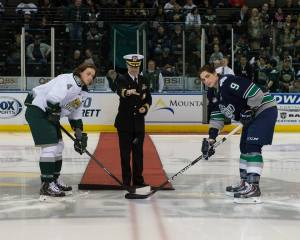 NRD Seattle Commanding Officer, Cmdr. Chris Sutherland, drops the ceremonial puck prior to the Everett Silvertips versus Seattle Thunderbirds game Feb. 21, at Comcast Arena.
