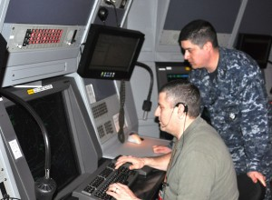 NAS Whidbey Island civilian air traffic controller Harold Edwards is pictured with acting radar supervisor Air Traffic Controller 1st Class Michael Zamarripa, who responded to a civilian flyer in distress. (U.S. Navy photo)