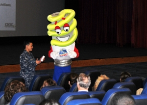 The Navy Shore Energy Program official mascot BRITE, right, and Navy Region Northwest Commander Rear Adm. Bette Bolivar, speak to civilian and military personnel at an All Hands Call Mar. 27 about the importance of energy conservation and ways to reduce energy consumption.  Energy bills are one of the largest costs for Navy installations so improving energy efficiency across the Navy is important. BRITE was created in 2008 in the Navy's Northwest region, and more recently became the official mascot for the Navy's entire Shore Energy Program.  (U.S. Navy photo by Liane Nakahara)
