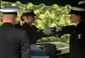 140416-N-MM360-070 ARLINGTON, Wash. (Apr. 16, 2014) Sailors fold a flag over the coffin of Chief Navy Counselor Billy Spillers during his funeral at Arlington Cemetery in Arlington, Wash. Spillers died, along with his children Jovon, Kaylee, and Brooke, when a mudslide struck his home in Oso, Washington on Mar. 22. Spillers is survived by his wife Jonielle and son Jacob. (U.S. Navy photo by Mass Communication Specialist 2nd Class Jeffry A. Willadsen/Released)