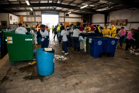 EVERETT, Wash. (Apr. 22, 2014) Teams of Sailors and civilians stationed on Naval Station Everett (NSE) participate in the 2014 NSE Earth Day Dumpster Dive April 22. The event was designed to promote recycling habits throughout the installation through hands-on experience. Navy and Marine Corps commands worldwide celebrate Earth Day on the official date of April 22 and throughout the months of April and May. (U.S. Navy photo by Mass Communication Specialist 1st Class Kyle Steckler/Released)