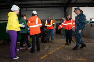 EVERETT, Wash. (Apr. 22, 2014) Capt. James J. Duke, Naval Station Everett (NSE) commanding officer, speaks with members of Naval Facilities Engineering Command Northwest's Integrated Solid Waste team while Sailors participate in the 2014 NSE Earth Day Dumpster Dive. The event was designed to promote recycling habits throughout the installation through hands-on experience. Navy and Marine Corps commands worldwide celebrate Earth Day on the official date of April 22 and throughout the months of April and May. (U.S. Navy photo by Mass Communication Specialist 1st Class Kyle Steckler/Released)