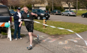 SILVERDALE, Wash. (April 25, 2014) Hospital Corpsman 2nd Class Christopher Towle crosses the finish line completing the 1.6-mile Take a Stand Against Sexual Assault run. The run was coordinated to help spread awareness of sexual assault throughout the Navy and educate Sailors on how to help prevent it. (U.S. Navy photo by Mass Communication Specialist 2nd Class Justin A. Johndro/Released