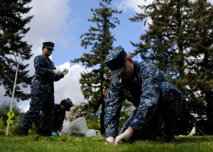 BREMERTON, Wash. (April 25, 2014) Sailors assigned to Naval Base Kitsap (NBK) Bremerton clears undesired brush from the grounds outside the command building during a base clean for Earth Day.  Earth Day allows team buildings across commands, military services and government agencies, and the local communities.  (U.S. Navy photo by Mass Communication Specialist 2nd Class Jamie Hawkins/Released)