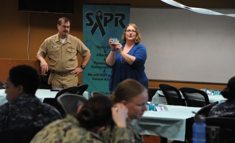 SILVERDALE, Wash. (April 30, 2014)  Capt. CJ Carter, Naval Base Kitsap's executive officer and Beverly, Mass. native, and Sharlyne Hays, NBK's Sexual Assault Response Coordinator, showcase the Advocate Survivor Kit favors presented when NBK's Fleet and Family Support Center hosted a breakfast to recognize Navy Region Northwest Sailors who serve as Sexual Abuse Prevention and Response victim advocates at NBK-Bangor. The Sailors were recognized for their dedication and efforts while serving the local Navy community as SAPR advocates. (U.S. Navy photo by Mass Communication Specialist 2nd Class Cory Asato/Released)