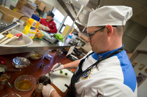 140510-N-MN975-022 BREMERTON, Wash. (May 10, 2014) - Culinary Specialist 1st Class Michael Gray, from Puyallup, Wash., prepares Balsamic Vinegar during an Armed Forces Iron Chef competition at Olympic College. Olympic College was host of the event as the 66th Annual Armed Forces Week kicked off in the Puget Sound area. (U.S. Navy photo by Mass Communication Specialist 2nd Class Justin A. Johndro/RELEASED)