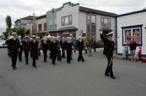 140524-N-DC740-019 Coupeville, Wash. (May 24, 2014) Members of the Navy Region Northwest Band march down Coveland Street during the annual Coupeville Memorial Day Parade and Picnic. Formerly known as Decoration Day, Memorial Day commemorates U.S. men and women who died while during military service. (U.S. Navy photo by Mass Communication Specialist 2nd Class John Hetherington)