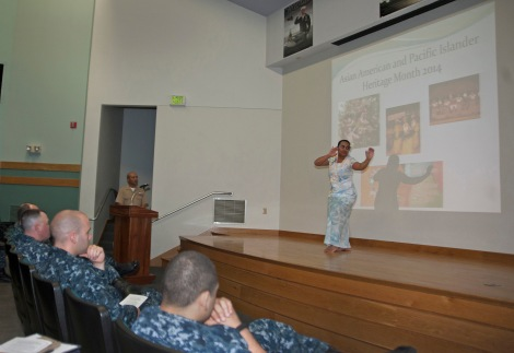 140530-N-MM360-031 EVERETT, Wash. (May 30, 2014) Culinary Specialist 2nd Class Christine Pritchett, from Suva, Fiji, performs a traditional Samoan dance during the Asian American and Pacific Islander Heritage Month celebration in the William E. Moore auditorium on Naval Station Everett. The purpose of the ceremony was to celebrate the rich heritage and history of Asian and Pacific Island cultures and acknowledge their great contributions to American history. (U.S. Navy photo by Mass Communication Specialist 2nd Class Jeffry A. Willadsen/Released)