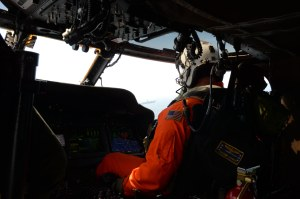 140613-N-DC740-124 OAK HARBOR, Wash. (June 13, 2014) Lt. Cmdr. Shane Jones, from Toledo, Ohio, assigned to Naval Air Station Whidbey Island's Search and Rescue unit, pilots an MH-60S Knighthawk above the aircraft carrier USS Nimitz (CVN 68) in the Strait of Juan de Fuca. Nimitz is underway hosting friends and family day, an event where nearly 400 civilian guests joined the ship's crew for a special one-day underway. (U.S. Navy photo by Mass Communication Specialist 2nd Class John Hetherington)