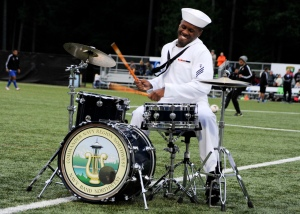 140613-N-OO032-075 BREMERTON, Wash. (June 13, 2014) Musician Seaman Micah Lewis, a Memphis, Tenn. native assigned to Navy Band Northwest, performs a drum solo during  halftime of the Kitsap Pumas's Military Appreciation Day soccer game. This is the band's inaugural performance at the event; however, the Pumas have hosted the event since Kitsap soccer club formed in 2009. (U.S. Navy photo by Mass Communication Specialist 2nd Class Cory Asato/Released)