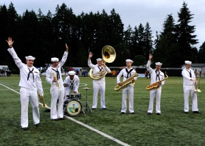 140613-N-OO032-082 BREMERTON, Wash. (June 13, 2014) Navy Band Northwest Sailors wave to the crowd after their performance during the halftime of the Kitsap Pumas's Military Appreciation Day soccer game. This is the band's inaugural performance at the event; however, the Pumas have hosted the event since Kitsap soccer club formed in 2009. (U.S. Navy photo by Mass Communication Specialist 2nd Class Cory Asato/Released)