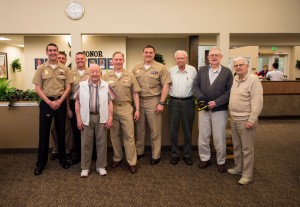 140618-N-MN975-010 PORT TOWNSEND, Wash. (June 18, 2014) - Sailors assigned to Naval Magazine Indian Island pose for a photo with World War II veterans at Seaport Landing Retirement and Assisted Living Community. Sailors from the region visit and interact with the veterans every month to show support and appreciation for their past service. (U.S. Navy photo by Mass Communication Specialist 2nd Class Justin A. Johndro/RELEASED)