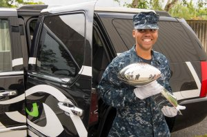 "140627-N-MN975-012 SILVERDALE, Wash. (June 27, 2014) Master-at-Arms Seaman Recruit Isaac McCoy, from Houston, carries the Superbowl XLIX trophy to be displayed at Naval Base Kitsap - Bangor. McCoy was selected from a drawing to be the only service member to handle the trophy while on display. Of this experience McCoy said ""this is the best experience of my short Naval career, I can't believe it. So Awesome."" (United States Navy photo by Mass Communication Specialist 2nd Class Justin A. Johndro/RELEASED)"