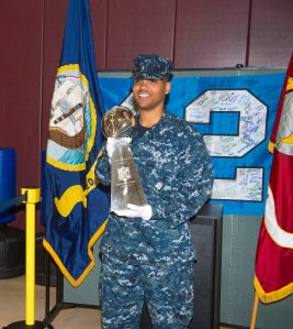 "140627-N-MN975-015 SILVERDALE, Wash. (June 27, 2014) Master-at-Arms Seaman Recruit Isaac McCoy, from Houston, carries the Superbowl XLIX trophy to be displayed at Naval Base Kitsap - Bangor. McCoy was selected from a drawing to be the only service member to handle the trophy while on display. Of this experience McCoy said ""this is the best experience of my short Naval career, I can't believe it. So Awesome."" (United States Navy photo by Mass Communication Specialist 2nd Class Justin A. Johndro/RELEASED)"