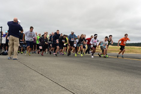 140719-N-DC740-009 OAK HARBOR, Wash. (July 19, 2014) Runners cross the starting line of the 5k on the flight line during Naval Air Station Whidbey Island's (NASWI) open house. The open house provides the general public an opportunity to interact with Sailors and learn more about NASWI's role both in the community and the Navy. (U.S. Navy photo by Mass Communication Specialist 2nd Class John Hetherington)