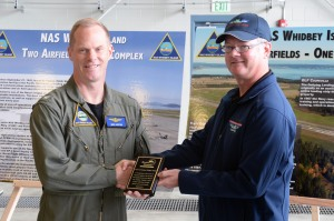 140719-N-DC740-133 OAK HARBOR, Wash. (July 19, 2014) Kevin Kelly, director of Washington Pilot Association's Aviation Academy, presents Capt. Mike Nortier, commanding officer of Naval Air Station Whidbey Island (NASWI), with a plaque thanking him for the base's continued support of the Aviation Academy program during NASWI's open house. The open house provides the general public an opportunity to interact with Sailors and learn more about NASWI's role both in the community and the Navy. (U.S. Navy photo by Mass Communication Specialist 2nd Class John Hetherington)
