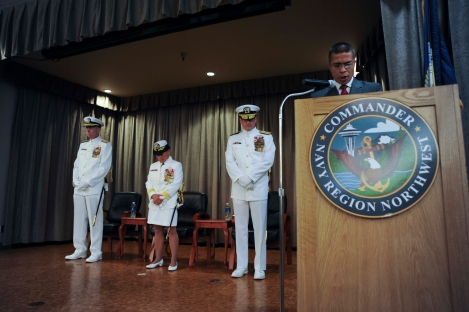 SILVERDALE, Wash. (JuLY 21, 2013) Retired Senior Chief Electronics Technician Thad Bolivar, brother of the departing commander, reads the invocation during the Navy Region Northwest change of command at Naval Base Kitsap's Bangor Plaza. Rear Adm. Jeffrey S. Ruth, a Key West, Fla. native, relieved Rear Adm. Bette Bolivar, a Honolulu native, as commander of the Navy's 3rd largest fleet concentration. (U.S. Navy photo by Mass Communication Specialist 2nd Class Cory Asato/Released)