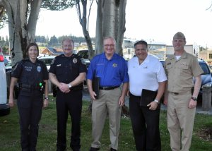 Naval Air Station Whidbey Island joins the City of Oak Harbor in the annual National Night Out at Windjammer Park on Aug. 5, 2014 to bring the public together with law enforcement and emergency services as part of crime and drug prevention awareness. Speaking at the event (from left) Oak Harbor Police Officer and event coordinator Jennifer Yzaguirre; Oak Harbor Police Chief Ed Green; Island County Sheriff Mark Brown; Oak Harbor Mayor Scott Dudley and Capt. Micheal Nortier, NAS Whidbey Island Commanding Officer. Not pictured is Master-at-Arms 2nd Class Andrew Eichman, the base National Night Out coordinator. The event generates support for local anti-crime programs; strengthens neighborhood spirit and police-community partnerships and sends a message to criminals that neighbors are organized and watching. (U.S. Navy photo by Tony Popp).