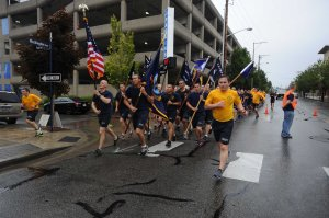 140830-N-OO032-079 BREMERTON, Wash. (Aug. 30, 2014) More than 200 Navy Region Northwest Chief Petty Officers Association members and Chief selects run to cadence during the 25th Annual Blackberry Festival's Chief Select 5k. The NRNW CPOA has been coordinating the run to kickoff the festival on the Bremerton waterfront since the festival's inception 25 years ago. (U.S. Navy photo by Mass Communication Specialist 2nd Class Cory Asato/Released)