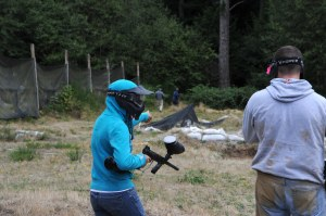 140908-N-OO032-418 POULSBO, Wash. (Sept. 08, 2014) Transient Personnel Unit Puget Sound Sailors coordinate a strategy while playing paintball during a unit cohesion pilot program at Island Lake Camp sponsored by Chaplain Religious Enrichment Development Operation Navy Region Northwest for NBK TPU. The program provides an informal environment for Sailors to focus on teamwork, communication and trust where they participated in events to include paintball and a high rope obstacle course. (U.S. Navy photo by Mass Communication Specialist 2nd Class Cory Asato/Released)