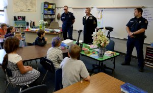 140911-N-MN975-010 CHIMACUM, Wash. (Sept. 11, 2014) - Military and emergency service members speak with students on behalf of Patriot Day at Chimacum School. After 13 years since the terrorist attacks on the World Trade Center schools around Puget Sound hold ceremonies on Sept. 11 to remember those who were lost and those who continue to serve in emergency and military services. (U.S. Navy photo by Mass Communication Specialist 2nd Class Justin A. Johndro/RELEASED)