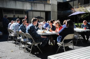 SILVERDALE, Wash. (Sept. 12, 2014) – Members of the Navy and Department of Defense celebrate high donations during the Fed Feed Families (FFF) program with a pot-luck lunch. The program was turned into a competition for the Commander Navy Region Northwest building 1100 to see which team could raise the most food from June 1 to the end of August. (U.S. Navy photo by Mass Communication Specialist 3rd Class Seth Coulter/ Released)