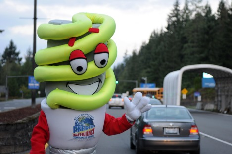 "141001-N-ZY850-005 SILVERDALE, Wash. (Oct. 1, 2014) – Department of the Navy energy conservation mascot ""BRITE"" greets oncoming personnel at Naval Base Kitsap-Bangor's main gate as part of the Navy wide Energy Action Month.  Commands around the world highlight energy initiatives, focus on energy-related aspects of planned public events, and support energy-orientated leadership speaking engagements throughout the month of October.  (U.S. Navy photo by Mass Communication Specialist 2nd Class Jamie Hawkins/ Released)"