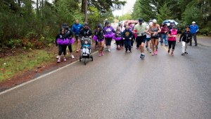 141015-N-MN975-008 SILVERDALE, Wash. (October 15, 2014) Runners participating in the Domestic Abuse Awareness 5K run at Naval Base Kitsap - Bangor take off from the starting line. October is Domestic Abuse Awareness Month and Navy Region Northwest held the event to spread awareness around the base community. (U.S. Navy photo by Mass Communication Specialist 2nd Class Justin A. Johndro/RELEASED)