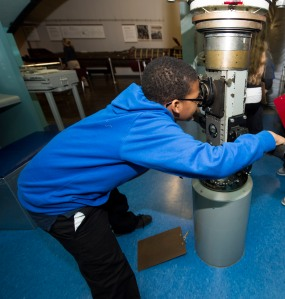 141016-N-MN975-016 KEYPORT, Wash. (October 16, 2014) A student from West Hills Science, Technology, Engineering and Math (STEM) Academy looks through a model submarine periscope during Navy STEM day held at the Keyport Naval Undersea Warfare Museum. The one-day workshop was offered to more than 100 students who participated in a variety of hands-on STEM activities and interacted with DoD educators about remotely operated vehicles (ROVs). (US Navy photo by Mass Communication Specialist 2nd Class Justin A. Johndro/RELEASED)